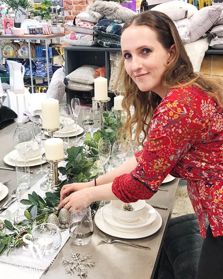 Sisley White setting the table for the Elys Wimbledon Stlye mag photoshoot for christmas 2019.