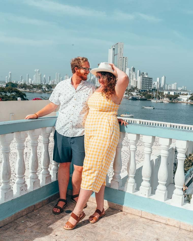 Lia and Jeremy in front of the skyline and ocean in Cartagena, Colombia