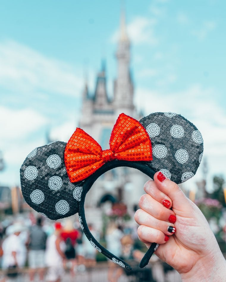Polka Dot Minnie Ears in front of the Castle at Disney World in Orlando, Florida.