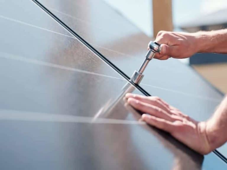 Solar Panel Person Screwing a Bolt