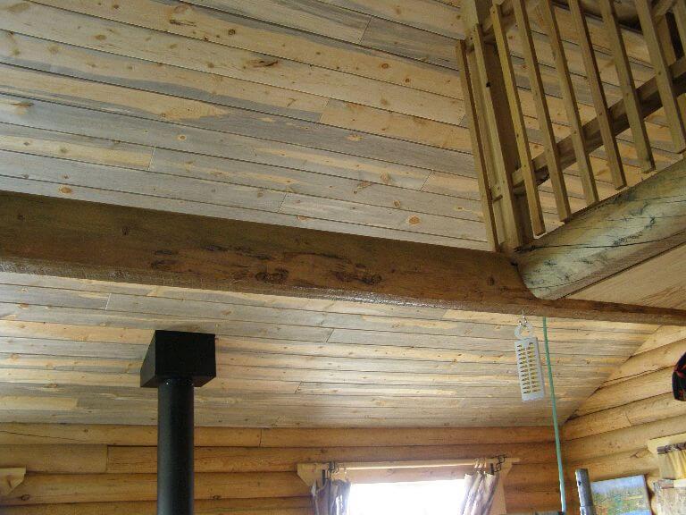 Custom wood ceiling and railing in remodel of cabin room in Wyoming