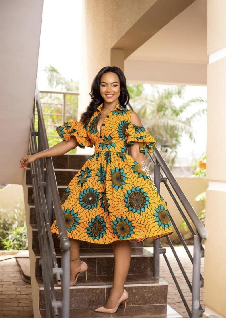 A corporate sexy cold shoulder African print dress