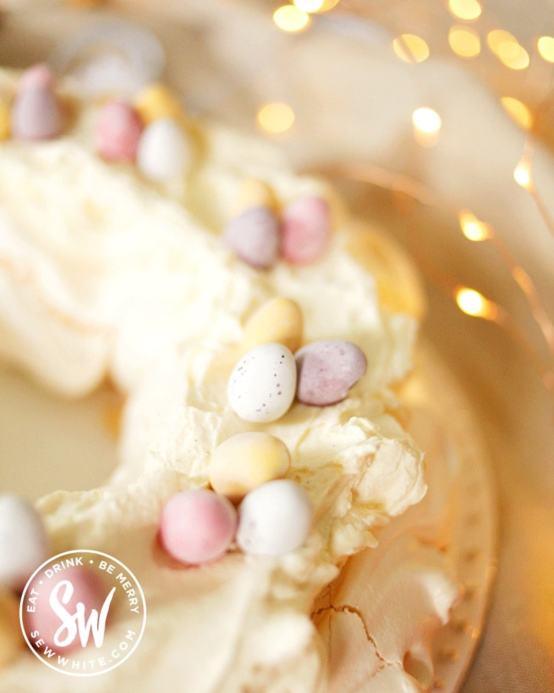 Close up of the Easter pavlova topped with pastel coloured mini egg chocolate eggs