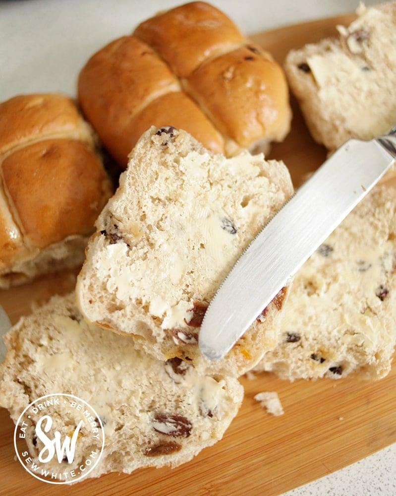 Hot Cross Bun Dessert - slicing up the hot cross buns and buttering them