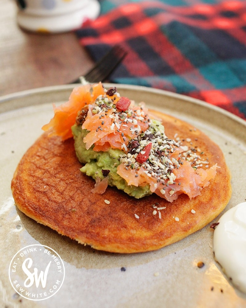Savoury pancake idea with smoked salmon, guacamole and seeds