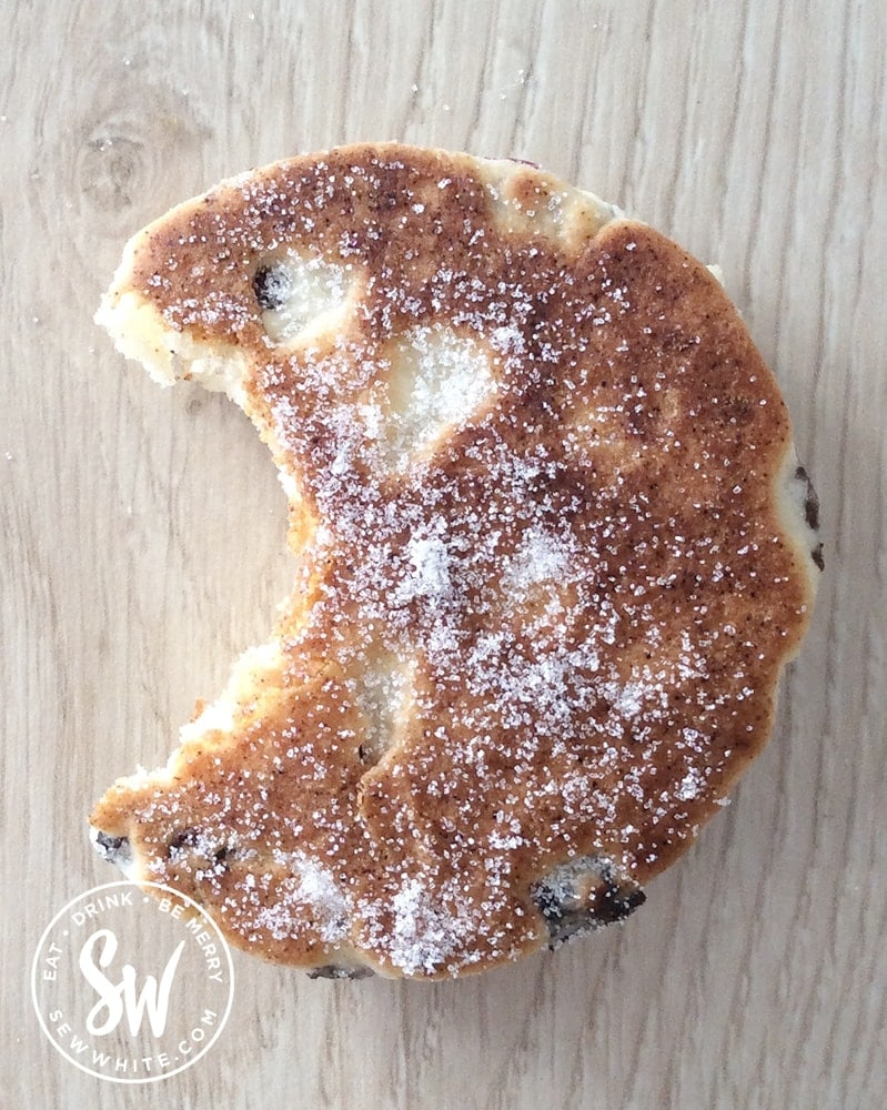 A bite taken out of a Cranberry and Lime Welsh Cakes