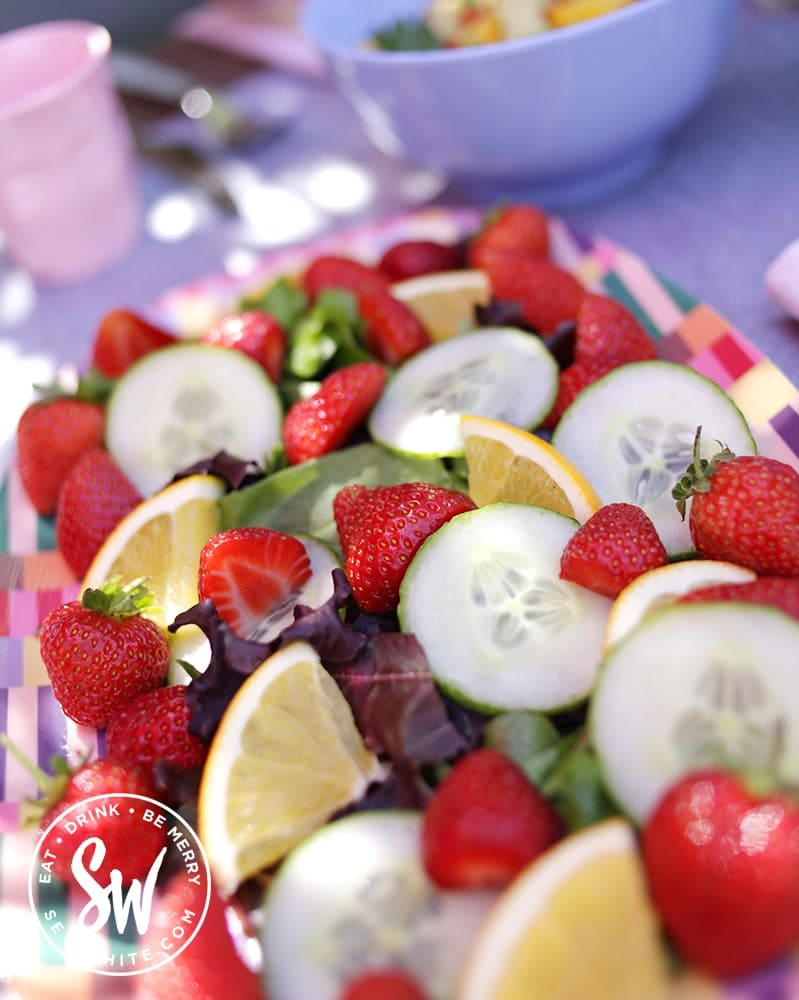 fresh strawberries, cucumber, mint and orange in a summer pimm's salad / pimms salad