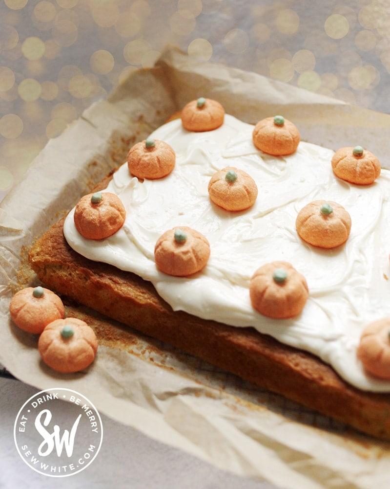 pumpkin traybake decorated with marshmallow pumpkins