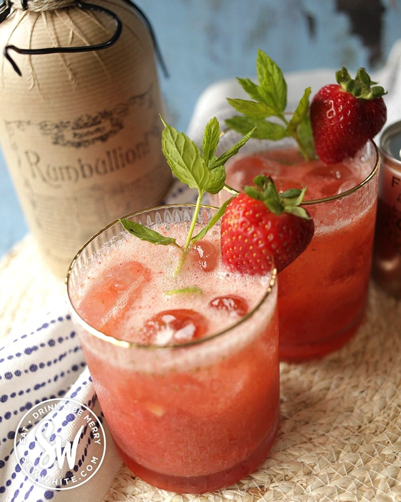Close up of the strawberry rum cocktail with fresh mint and strawberries