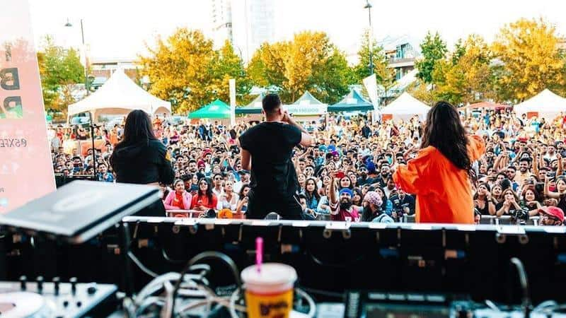 BFunk dancing with singer Jaz Dhami at the Surrey Block Party on June 15, 2019. Image via Facebook, used with permission from VIBC.