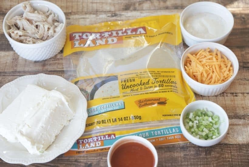 These Baked Buffalo Chicken Flautas as crispy, cheesy and full of buffalo chicken flavor. Feed a crowd this Cinco de Mayo with these delicious Baked Buffalo Chicken Flautas. If you love Mexican food, try this easy Mexican recipe. Flautas are quick and easy to prepare. Flautas are a great make-ahead freezer meal too.