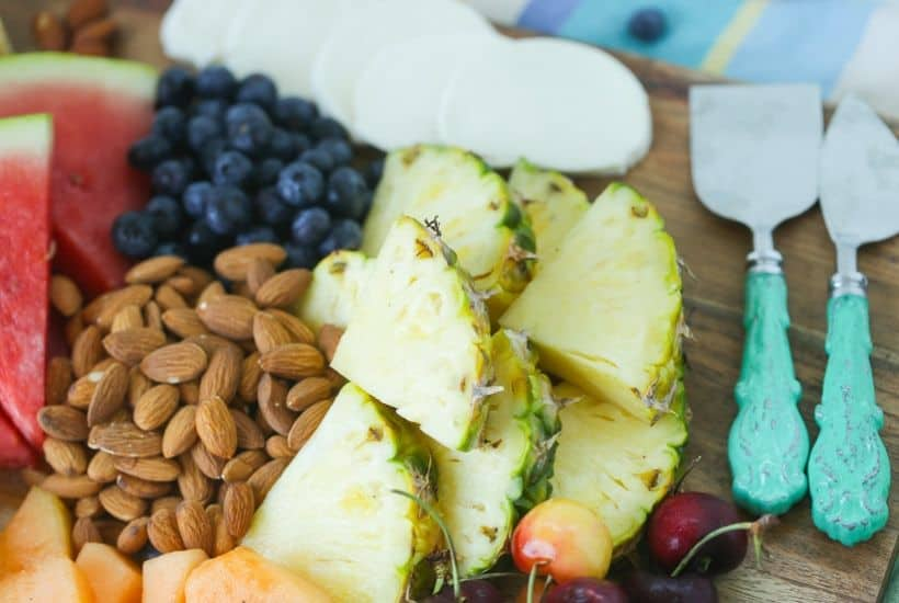 Take summer entertaining to the next level with this easy Summer Fruit And Cheese Board. This fruit and cheese board is an easy party recipe.