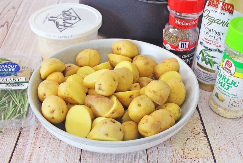 Lighten up your side dish routine with this easy Air Fryer Parmesan Rosemary Potatoes. This is a delicious weeknight or holiday side dish. We all love potato recipes and this potato recipe is quick and easy. This air fryer recipe is a healthier version of the classic roasted potatoes. Your family will love this healthy air fryer potato recipe. #potatorecipe #airfryerrecipe #airfryer #healthyrecipe