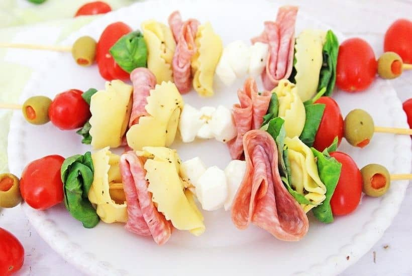 These make-ahead Tortellini Antipasto Skewers Appetizers are an easy and delicious party recipe or snack idea. This super easy antipasto recipe feeds a crowd too.