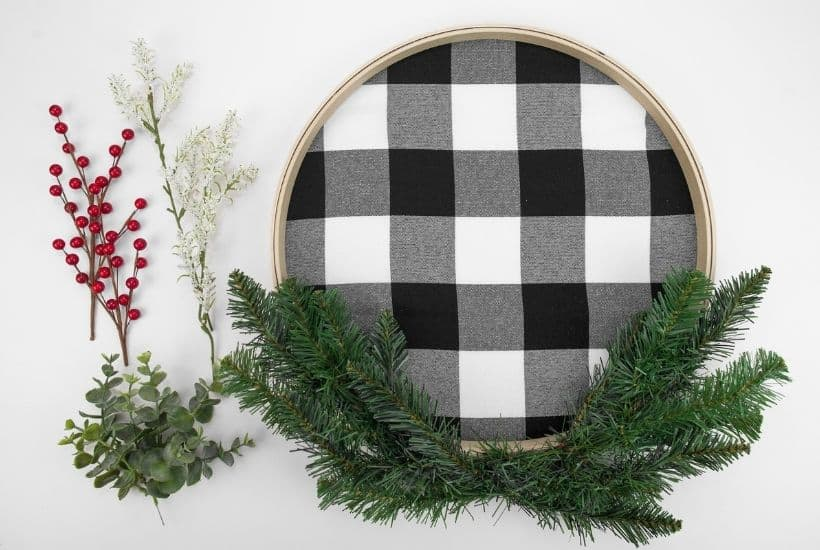 It's not a farmhouse Christmas without buffalo plaid and a vintage red truck. This Buffalo Plaid Christmas Hoop Wreath is an easy farmhouse Christmas craft.