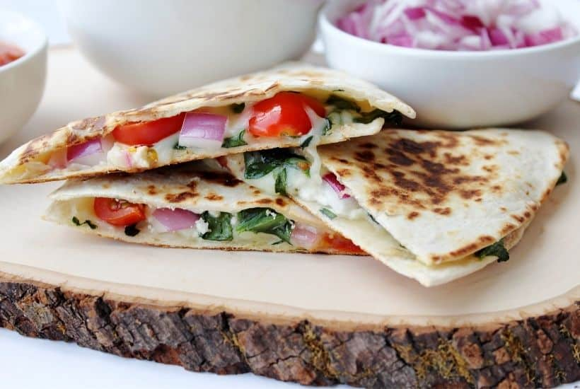 If you love the classic cheese quesadilla, then you will love this fun twist. Use this Mediterranean Quesadillas recipe to prepare a cheesy meat-free meal full of fresh vegetables. These quesadillas are perfect to eat for breakfast, lunch, or dinner! This easy quesadilla recipe is a delicious meatless meal idea. It's a perfect sandwich recipe for lunch or dinner.