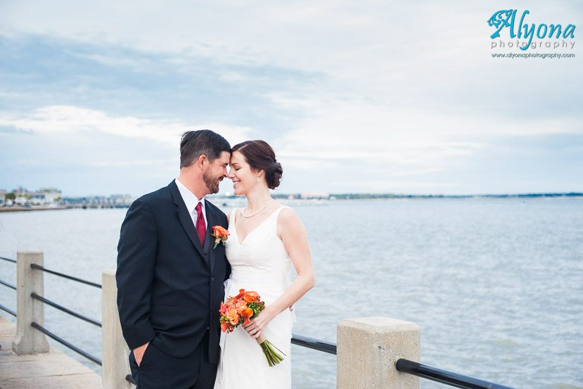 wedding couple on Charleston Battery with water in the background