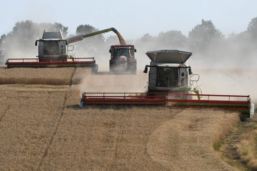 """2019-07-23 18:35:33 A French farmer and agricultural contractors harvest a wheat field, with two tracked combine harvester of 12 and 9 metres wide, in the hilly fields of """"Le Perche"""", in Combre, northwestern France, on July 23, 2019.  Jean-Francois MONIER / AFP"""