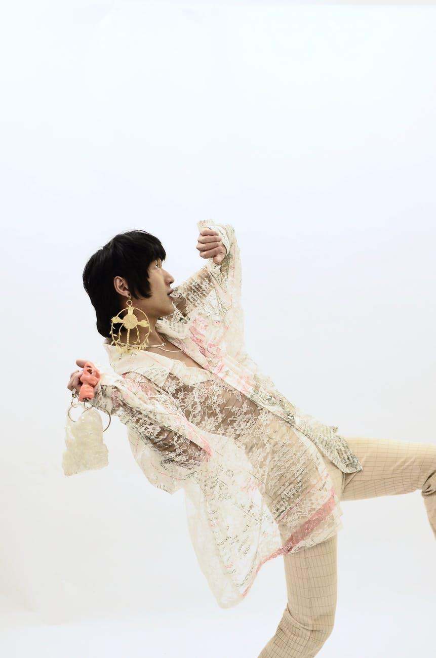 stylish ethnic man dancing in studio