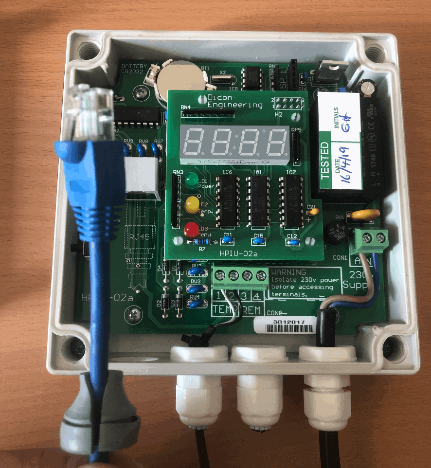 Removed patch cable from inside the Reclaim Energy heat pump controller