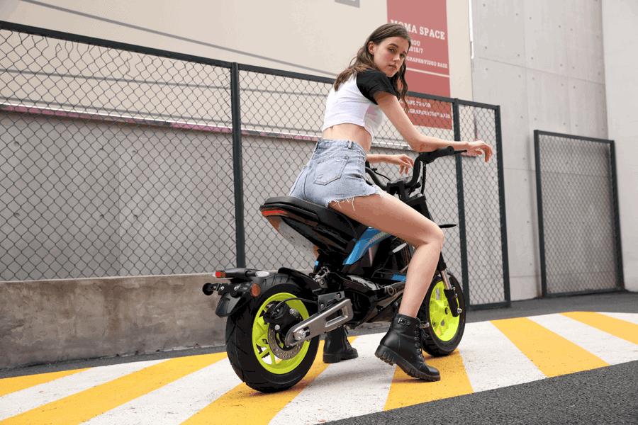 female-on-tromox-blue-motorcycle