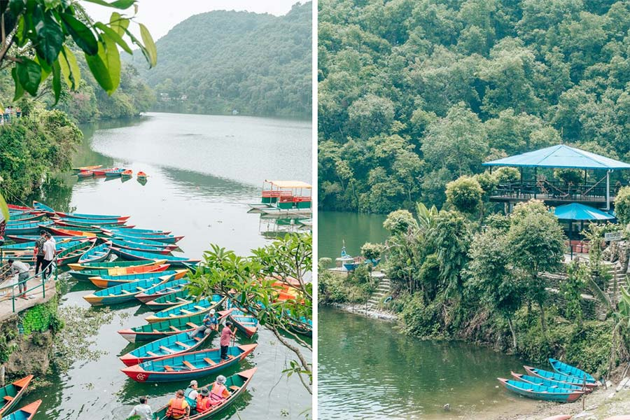 The view from above of the bright blue canoes on Pokhara Lake