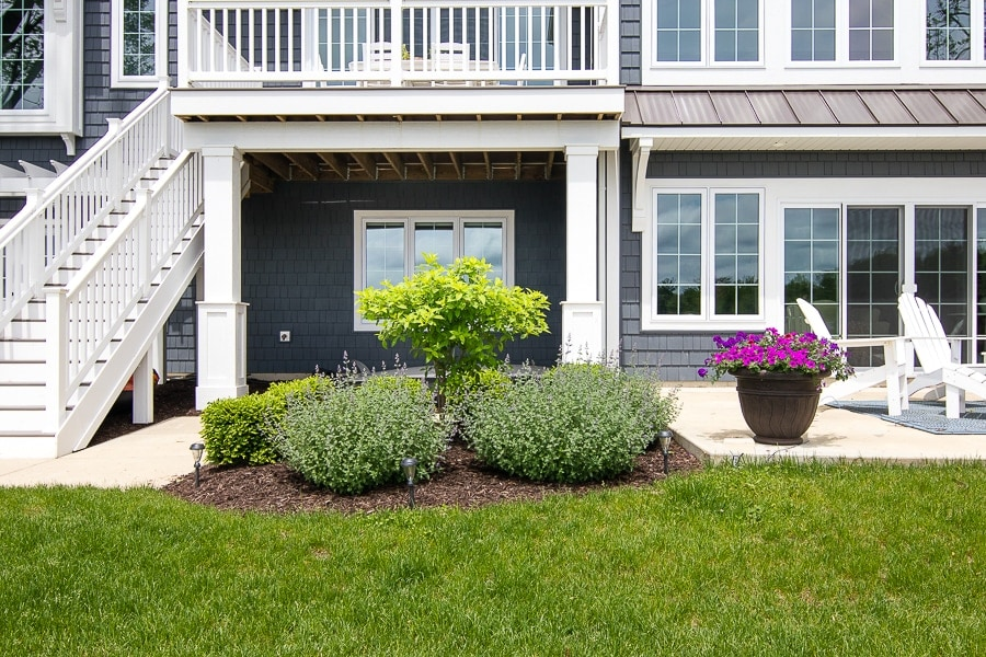 dark grey exterior lake house and landscaping