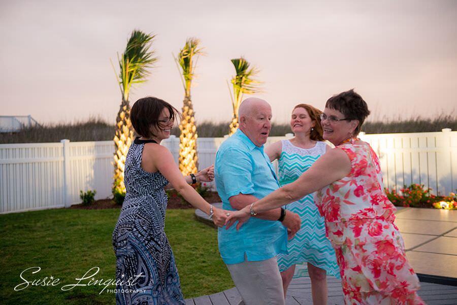 Outdoor tree uplighting beach house lighting wedding reception Ocean Isle Beach Susie Linquist