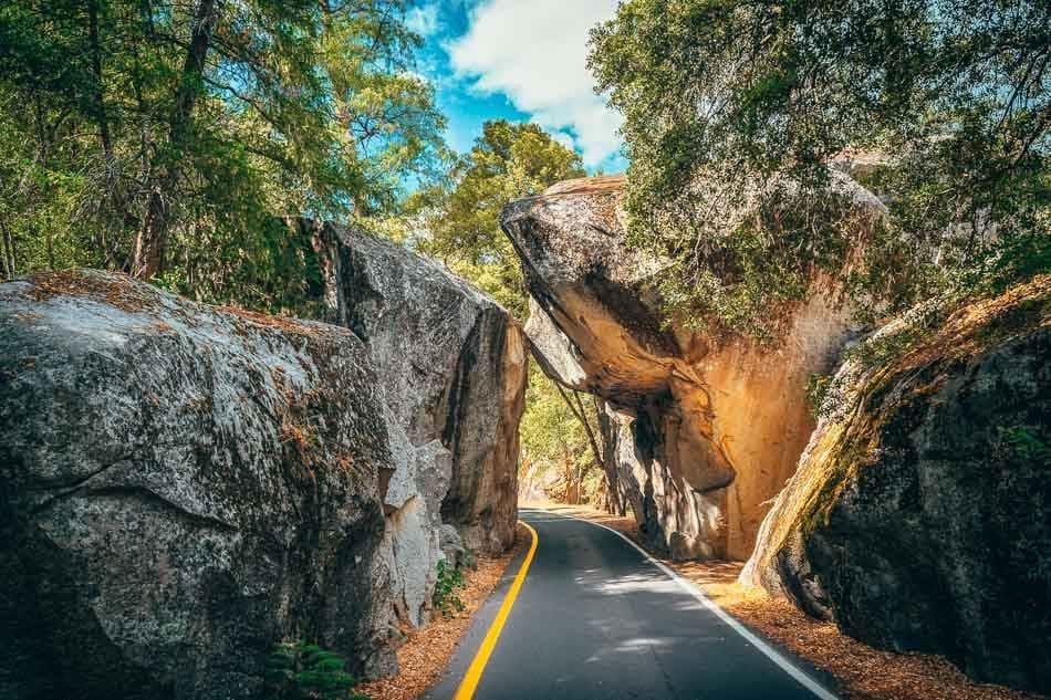 Highway 140 passing through Yosemite's iconic granite Arch Rock Entrance