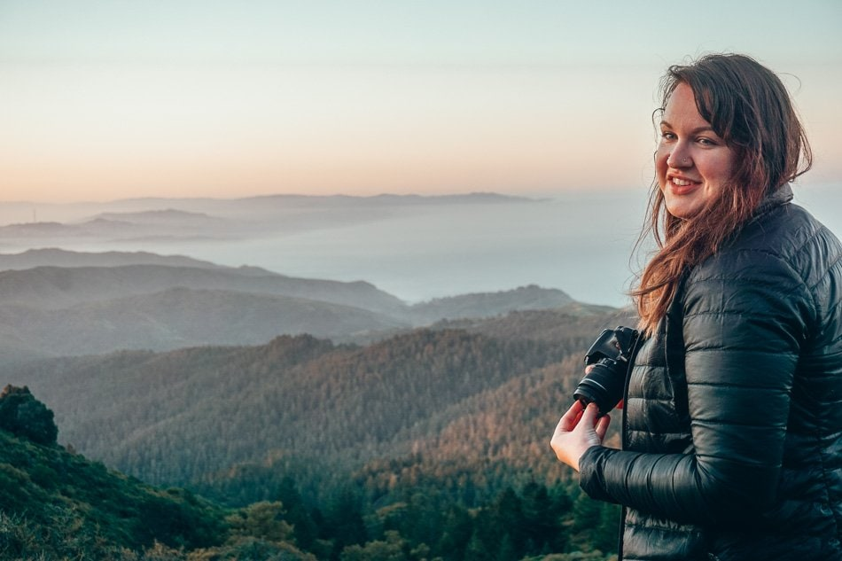 Lia Garcia, Travel blogger & photographer watching the sunrise over Mount Tamalpais, California.