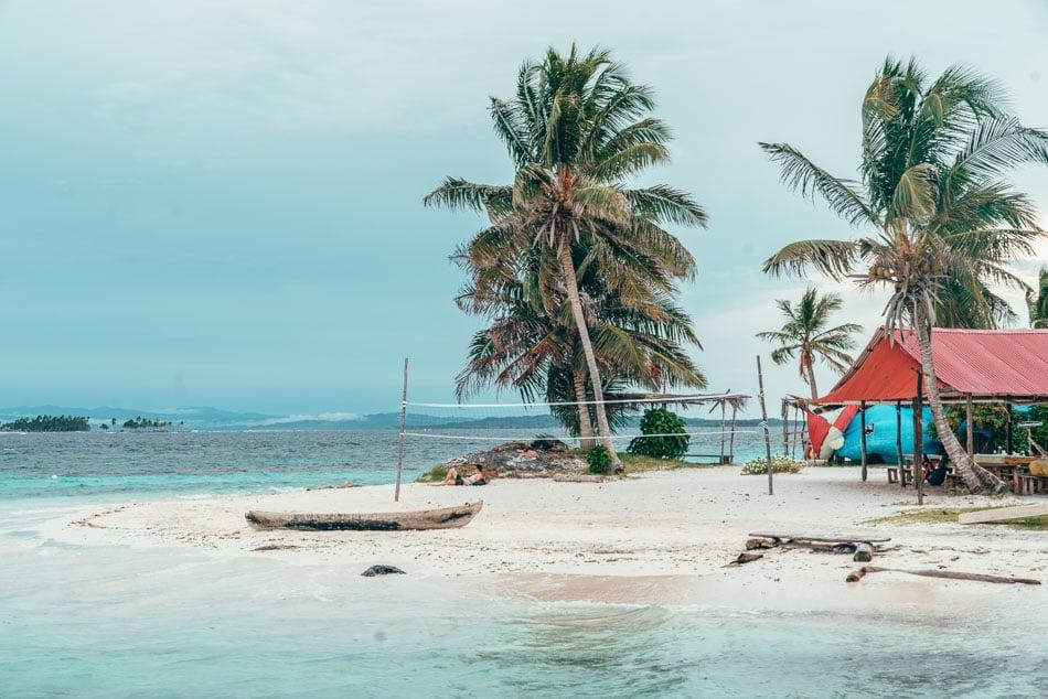 Boat and volleyball net on the beach in the San Blas Islands aka Guna Yala, Panama.