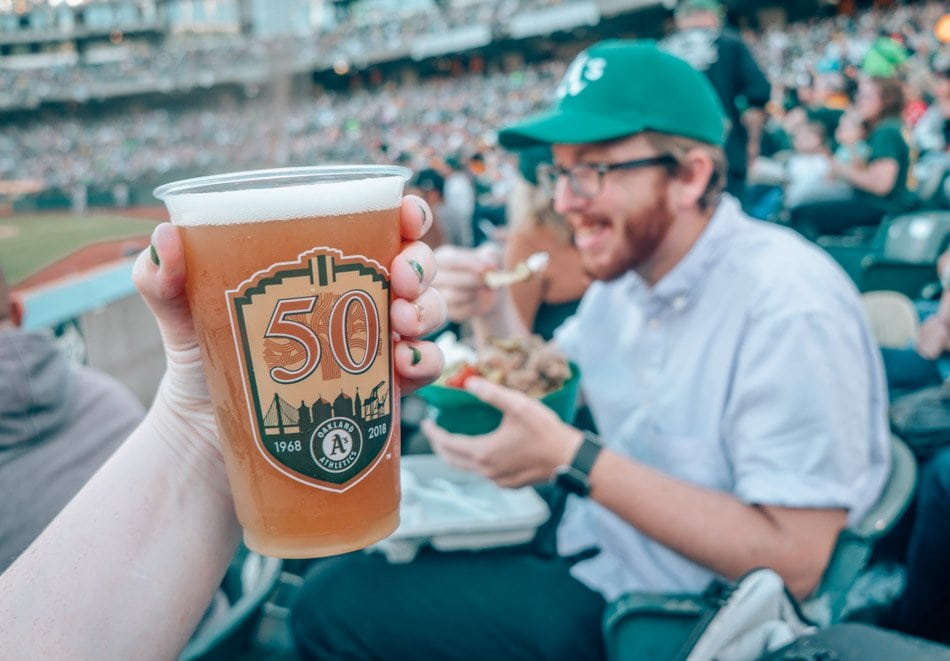 Oakland Athletics 50th Anniversary beer cup at a baseball game in Oakland, California. One of the best things to do in Oakland.