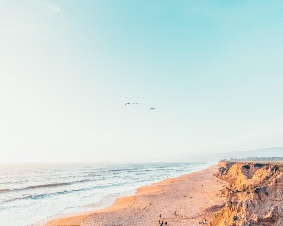 The beach at sunrise in Half Moon Bay, California.