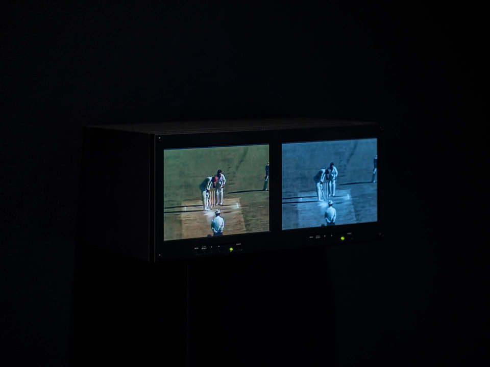 Timothy Yanick Hunter, Playing Field (Repetitions), Two Channel Video, Dual Rack Monitor,1:43min, 2021, video clips sourced from West Indies vs Australia, Third Test Match-The Adelaide Oval [1980]