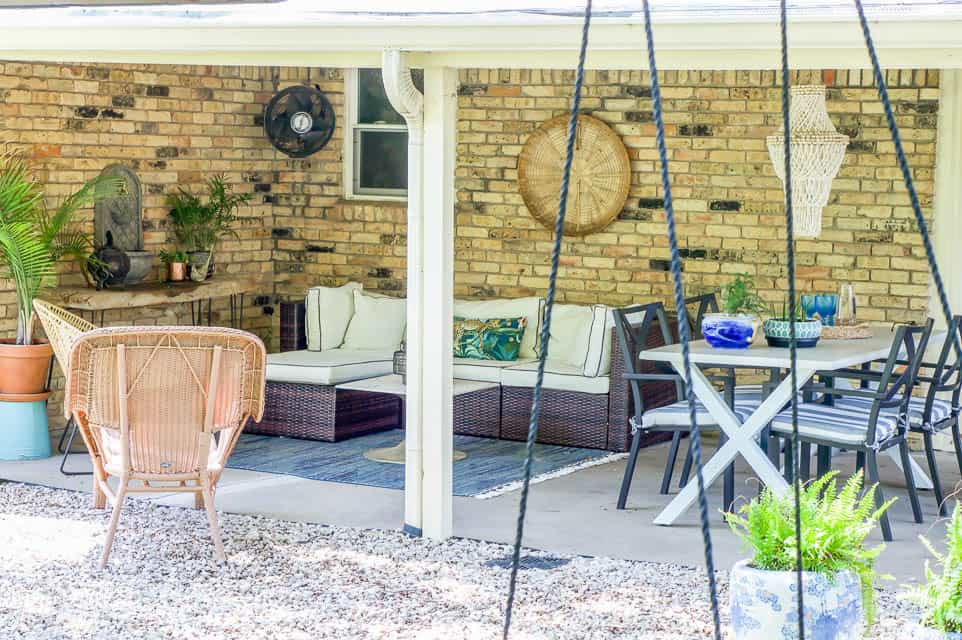 living spaces outdoor with a seating area and dining area on back porch.