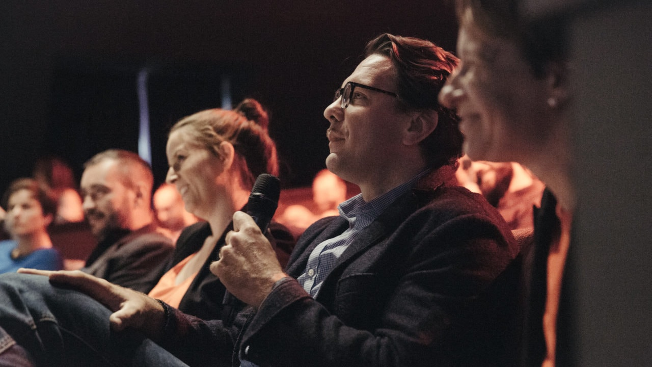 An event photo showing Corporate Members at a Community Event Q&A.