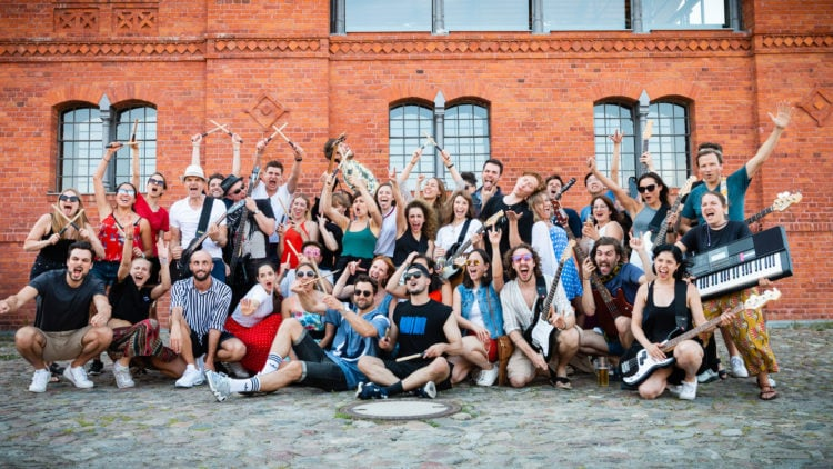 Employees of Factory Berlin in team photo.