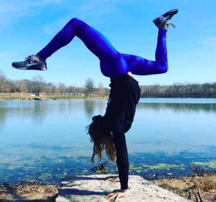 Women balancing near a lake