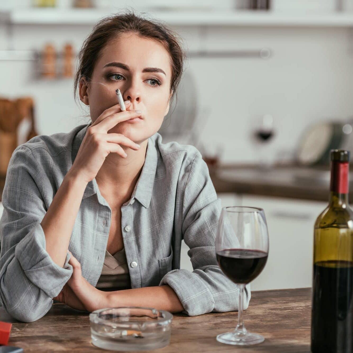 woman smoking and drinking wine