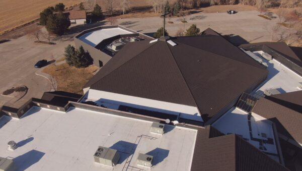 Top view of Rocky Mountain Christian church with metal roof and TPO flat roof