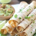 These Baked Buffalo Chicken Flautas as crispy, cheesy and full of buffalo chicken flavor. Feed a crowd this Cinco de Mayo with these delicious Baked Buffalo Chicken Flautas.