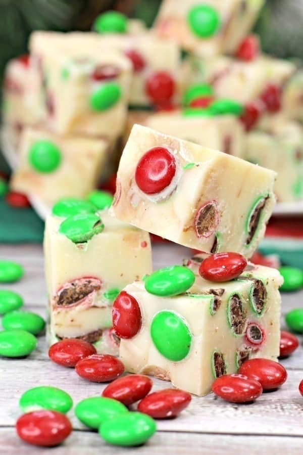 Tisthe season for some sweet treats. This festive 3-Ingredient Holiday Fudge only takes a few ingredients and a few minutes to make and is so delicious! #FudgeRecipe #Fudge #Candy #ChristmasCookies #HolidayFudge #ChristmasRecipe #CandyRecipe #Christmascookieexchange #Christmascookierecipe #ChristmasCookies