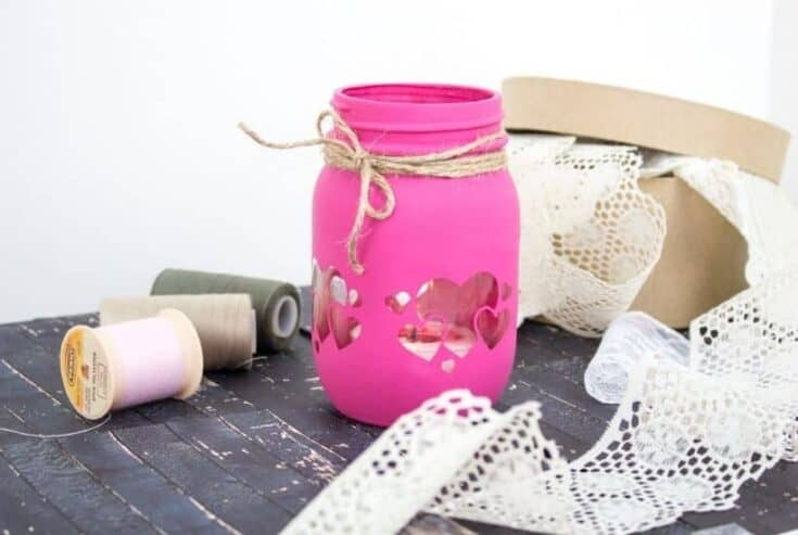 Grab some chalk paint and transform a mason jar into these Painted Mason Jar Valentine Lantern. This is an easy DIY Valentine's Day craft. Easy cricut craft project.