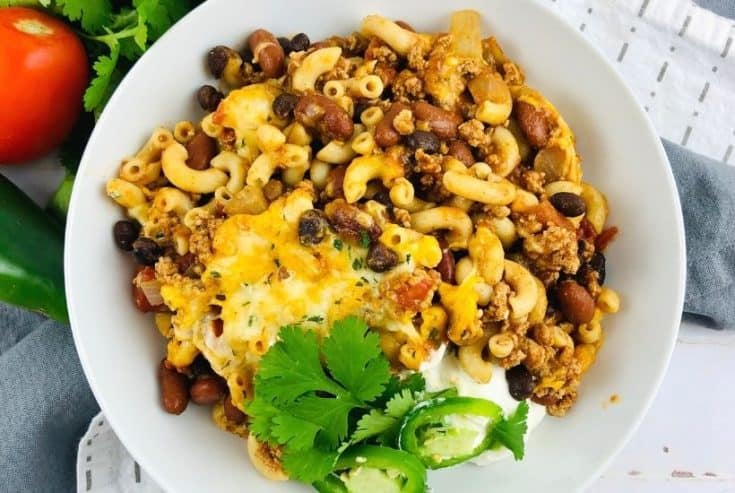 Prepare a fulfilling meal for the family with this wholesome and hearty Chili Mac. Loaded with flavor, this easy comfort food recipe is perfect to make for lunch or dinner with a side of cornbread or garlic bread! Chili Mac and Cheese is an easy weeknight meal idea.