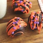 Fall is in the air and that calls for a warm treat. These Halloween Hot Cocoa Bombs are a perfect way to celebrate fall. Hot cocoa bombs for fall are filled with hot chocolate mix, miniature marshmallows and are nestled inside a delicious chocolate shell