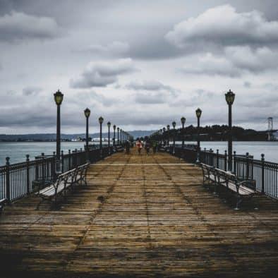 brown-wooden-bridge-near-body-of-water-1024862