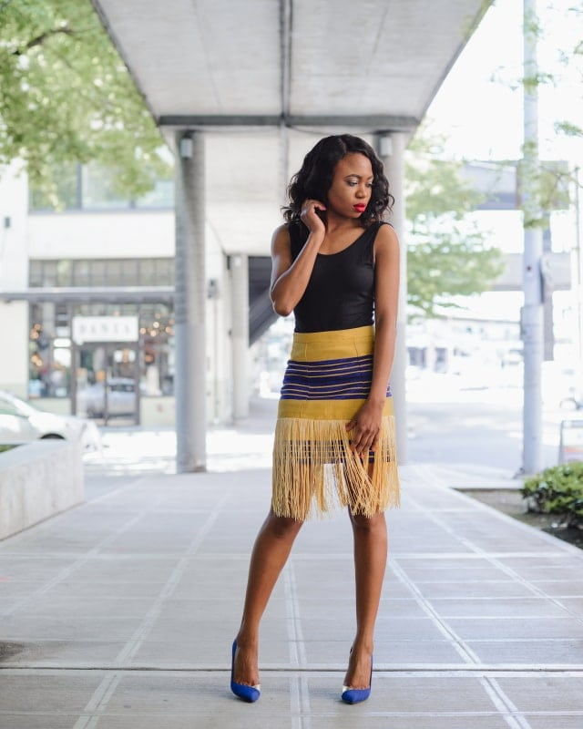 Keeping it simple and chic with a custom-made Nigerian aso oke fringe skirt paired with an open back sleeveless bodysuit. Visit the blog to for more.