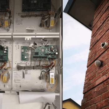 Camera on wall and alarm panel