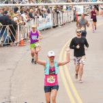 female runner finish line grandmas marathon