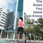 female runner crossing a city street
